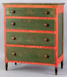 Pennsylvania, Furniture: A Mahantongo Valley, Pennsylvania, painted pine chest of drawers, circa 1830, inscribed Elisabeth Maurer, retaining remnants of its original decoration with green drawers and potato-stamp case on a salmon ground. Having four drawers, paneled sides and turned legs in black paint.