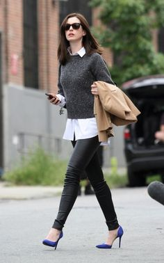 Just perfect- black leggings, white shirt, charcoal jumper, classic black sunnies lifted by cobalt blue stilettos and with a taupe trench for those unpredictable showers. Anne Hathaway and How to Do Transitional Dressing Right - Vogue