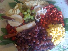 An easy to do fruit plate for a party ... grapes, strawberries, three types of cheese (goat, blue cheese, and brie), and crackers. Arrange on a large serving platter with serving knives.