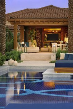 Resort style living created in a backyard with an outdoor room and swimming pool. Landscape design Brisbane