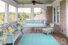 Back porch with swing - Greystone Country House in Kentucky by Stonecroft Homes