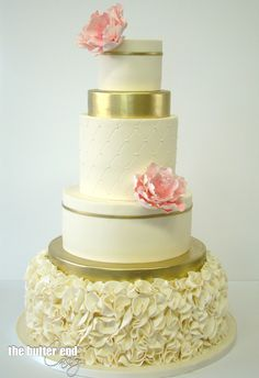 Blush and gold frilly wedding cake with pink sugar flowers by The Butter End Cakery