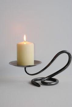 Google Image Result for http://www.scottish-highland-giftshop.com/ekmps/shops/windows/images/belltrees-forge-single-round-candlestick-8-p.jpg