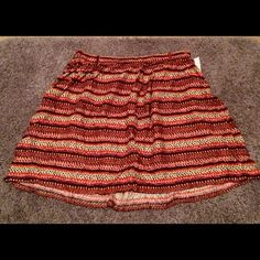 BNWT Mossimo Aztec pattern skirt This skirt is a lovely combo of pinks, reds, and neutrals. Elastic waist and flowy fabric. Mossimo Supply Co Skirts Midi