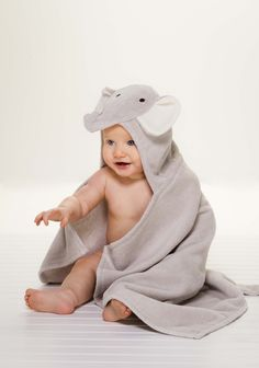 This precious hooded bath towel is a special gift for baby! Featuring a cute, classic gray elephant design, you can keep baby cozy and dry in this soft and plush baby bath wrap.