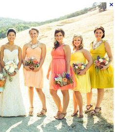 Multi-colored sunset themed bridesmaids dresses.