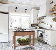 Cement tile and wood accents in this small but charming kitchen