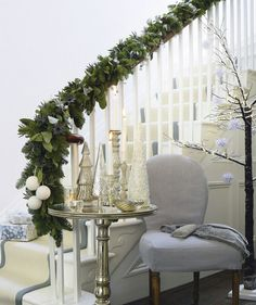 We love this elegant entry decorated in a green, silver, and white color palette.