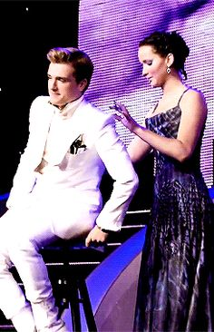 I love those two > Catching Fire Behind The Scenes GIF. i would love to be friends with them