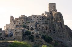 """Ghost Town of Craco - Basilicata - Matera ~ Around 540AD the area was called """"Montedoro"""" and inhabited by Greeks who moved inland from the coastal town of Metaponto. The remaining 1,800 residents (now down to 970) moved to a valley following an earthquake in 1963."""