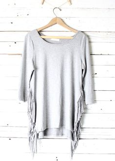 Super cute 3/4 sleeve with 7 inch fringe along side seam.  Will pair great with jeans and boots this fall.     Made in the USA  Rayon/Spandex  21 inch bust and 29 inches long (taken from size small, add 1/2 inch for next size up).