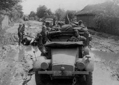 "Waffen SS Div "" Hermann Göring "" truck Krupp Protze passing a Motorcycle stuck in the mud"