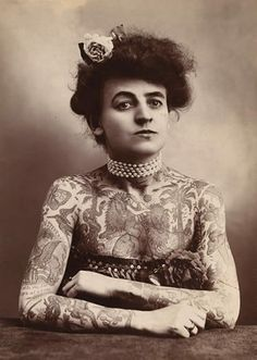This is Maud Stevens Wagner. She was the first female tattoo artist to gain fame in the United States, having learned the art from her husband. Maud was also a circus performer, which I guess explains why she was able to carry off such an unusual look in the early 20th century!