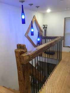 Barn beam railing Painted rebar balusters Recycled glass bottle lights