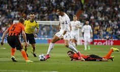 Cristiano Ronaldo of Real Madrid is challenged by Olexandr Kucher and Darijo Sma of FC Shakhtar Donetsk during the UEFA Champions League Group A...