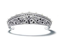 Russian-influenced tiara by CartierTiara in platinum, with round old-cut diamonds, 15 natural pearls, calibré, and fancy-cut onyx, black enamel.c. 1914