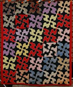Drunkard's path quilt ca. 1900 with an unusual black background