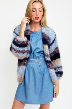Oversized, fuzzy and warm: this multicolor cardigan is handmade from high-quality wool and will make you feel cozy all winter. This stand-out knited dream will add a luxurious feel to your look. By Les Tricots D'o. Available at Sienna Faye.