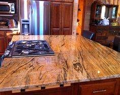 Peregrine granite...reminds me of sand or wood grain...soft looking but colorful