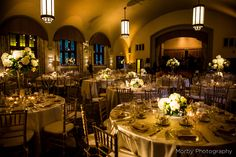 Champagne amber uplighting and pin spotting of the floral centerpieces and wedding cake for a wedding at the Merion Tribute House. Photo by Morby Photography. Lighting by Synergetic Sound + Lighting. www.synergeticsounds.com