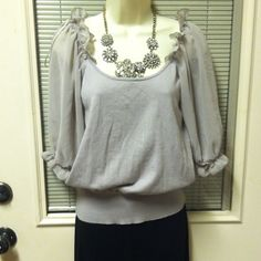 """  """"HOST PICK 5-10-15 ELLE"" "" HEATHER GRAY TOP! Beautiful heather gray top. Sheer arms and ruffles at the top of sleeves!! Bodice 100% cotton. Sheer arms are 100% polyester!! Elle Tops"
