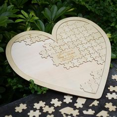 This sweet alternative to a traditional guest book can be a memento at home in your married life together. Guests simply take a wooden puzzle piece, sign and