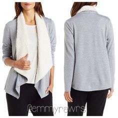 The BAILEY Gray Open Sherpa Lined Cardigan Lightweight marked knit fabric forms the perfect long sleeve cardi, with a Sherpa lined collar that cascades into an asymmetrical, open front. Tops
