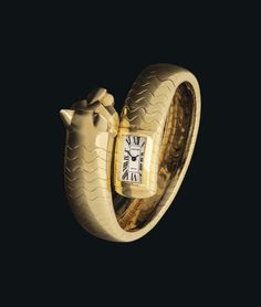Cartier. A lady's very fine and very rare 18K gold and emerald-set bangle watch. circa 1995. #ChristiesWatches