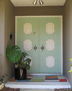 Mid-Century Modern Front Door - Love the colors and starburst door handle frames! #doors #green