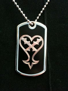 Kingdom Hearts Heartless Symbol Dog Tag Necklace by ambersunset, $10.00. Approx RM 31. Looked for a Nobody dog tag but there isn't one. Strange. I'm pretty sure I saw one on the Tumblr post. Hmmm.
