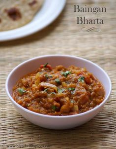 Baingan Bharta #Recipe - An aromatic Indian #curry made with roasted eggplants, onions, tomatoes and spice | blendwithspices.com ....