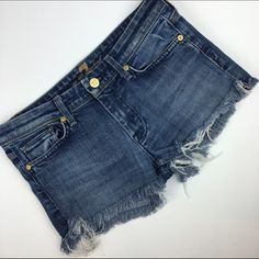 """[7FAM] Cutoff Jean Denim Shorts Boho Festival DIY Soft and broken pair of cutoffs. Crafted from a pair of 7 jeans. Frayed edges with slits on the sides to allow for ease of movement.   Waist: 15"""" Rise: 8"""" Inseam: 1.5"""" Condition: EUC. Distressed by design.  No Trades! 7 for all Mankind Shorts Jean Shorts"""