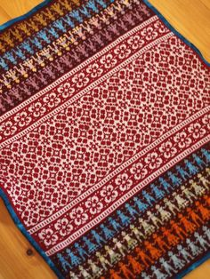 Latvian Garden Party by craftivore, free pattern is here : http://www.ravelry.com/patterns/library/baby-blanket-latvian-garden