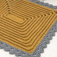 Virkkaa hieman erilainen matto: Keltainen kohoraitamatto sopii kylppäriin, sängyn vierelle tai kynnysmatoksi.