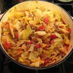 Unstuffed Cabbage: 1 1/2 to 2 pounds ground beef 1 tablespoon EVOO 1 large onion, chopped 1 clove garlic, minced 1 small cabbage, chopped 2 cans diced tomatoes 1 can tomato sauce 1/2 cup water 1 tsp pepper 1 tsp salt In a large skillet, heat EVOO over medium heat. Add the beef & onion cook. Add garlic. Add cabbage, tomatoes, tomato sauce, S&P. Bring to a boil. Cover and simmer 20-30 minutes Yield: Serves 6 to 8.
