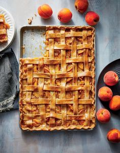 Peach-Vanilla Slab Pie | The next time you need a dessert for a crowd—backyard barbecue, picnic, block party, or potluck—think slab pie. This version pairs juicy peaches with heady vanilla bean; we opt for vanilla bean paste, but you can also use an equal amount of vanilla extract. You'll need to patiently work with the dough to roll it out large enough to cover the pan. Don't worry about overworking it; it's so thin that it can't get tough.