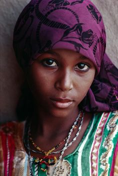 Yemen by Steve Mccurry - What a beautiful young lady. Her features are perfect and her eyes are lovely.