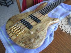 2006 Ibanez 5-string bass in spalted maple. It has Bartolini Pickups and custom matching spalted maple knobs. Lightly used (slight buckle rash on the back), mostly excellent condition. I have not found another of this model that looks like this. BUY IT