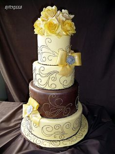 Chocolate and yellow layered wedding cake