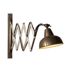 Industrial at heart, this Bennett Extendable Wall Lamp