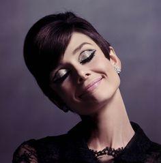 Audrey Hepburn. Eyes closed. Happy.