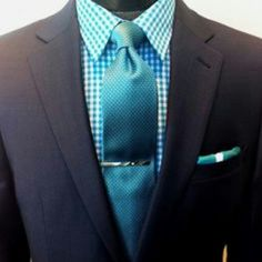 Black suit with teel green shirt and tie