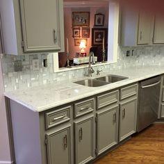 Glass mosaic backsplash and White River Granite counter