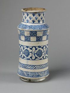 Drug jar      Place of origin:      Paterna, Spain (possibly, made)     Manises, Spain (possibly, made)     Date:      ca. 1400 (made)     Artist/Maker:      Unknown (production)     Materials and Techniques:      Tin-glazed earthenware     Museum number:      47-1907