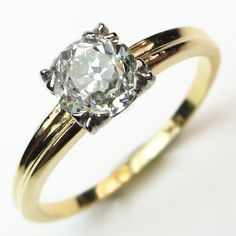 Old Gold: A sleek, minimalist yellow gold mounting holds a chunky antique diamond with tremendous sparkle and a distinctive personality. Maloys.com