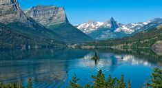 First Run (The first run of the tour boat on St. Mary Lake in Glacier National Park early in the morning...)  by Joan Herwig on 500px