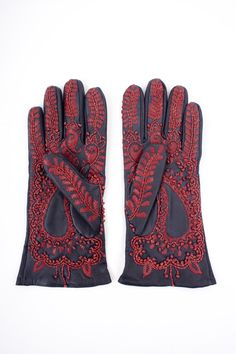 Applique leather embroidery inspired by henna tattoos . Gloves by Charlene Mullen
