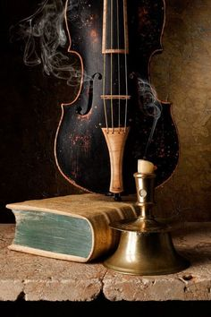 violin, candle, book