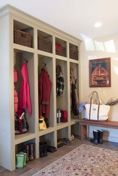 Mudroom/Entry - would put doors to cover jacket and shoe areas.  Use dark color.