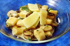Potato Gnocchi with Kale and Mushrooms in a Goat Cheese Sauce | Potato gnocchi is a hearty and decadent, yet versatile dish that can be flavorful dressed up in even the healthiest preparations.